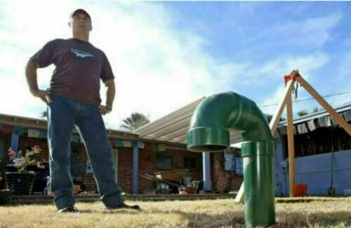 John standing in his backyard